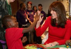 Catherine, Duchess of Cambridge takes part in some drumming 'music therapy' as she attends the Anna Freud Centre Family School Christmas Party at Anna Freud Centre on December 15, 2015 in London, England. The Duchess joined groups of families in Festive activities designed to help pupils reflect on the positive progress in their social relationships and communication skills.