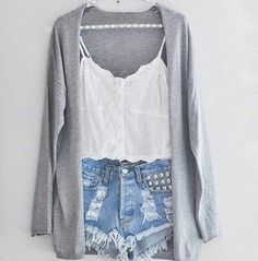 Grey cardigan and white tank top with ripped shorts.
