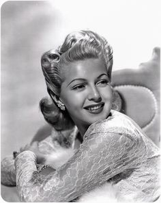 Lana Turner and her amazing 40s hair rolls, an older cousin of victory rolls.