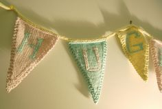 Hand-knit bunting -- for extra-festive party decor (and for getting rid of stash yarn)!