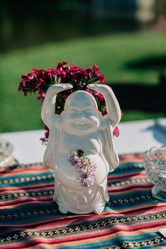 Buddha centerpiece :) photo by Lev Kuperman http://ruffledblog.com/kaaterskill-ny-wedding #weddingideas #centerpieces