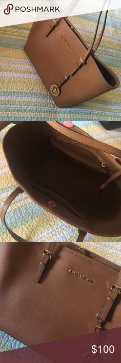 Michael kors small jetset in brown Michael Kors  a small brown bag it's in excellent condition Michael Kors Bags Shoulder Bags