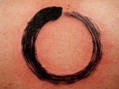 zen brushstroke circle minimal black tattoo