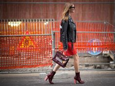 red lace Valentino dress, Louis Vuitton boots, ShopJayDee customized leather jacket and Hermès Kelly vintage bag with stickers by Anya Hindmarch.