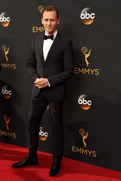 """Nominee as lead actor in """"The Night Manager"""" and presenter Tom Hiddleston at the 68th Annual Primetime Emmy Awards 2016 wore a Gucci midnight blue two-button Monaco tuxedo with a white pleated evening shirt, grosgrain bee printed bowtie and patent leather lace-ups."""