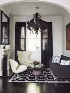 Yes to the floor, chandelier, and curtains for a living room!