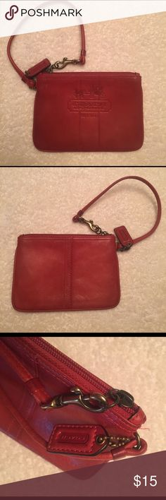 Authentic Coach Vintage Look Red Wristlet This Wristlet is red vintage looking. The red is like a tomato color. Inside has fun plaid. The leather is like a vachetta. It gets better and softer with use. In very good condition. Brass hardware with Coach fob attached. Coach Accessories Key & Card Holders