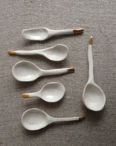 Image of a set of six gold tipped tasting spoons