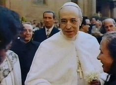 Pope Pius XII greets people on 80th birthday in frame from film preserved at Vatican