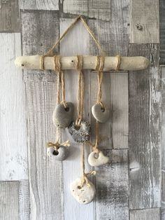 Hag Stone and Driftwood Coastal Decor! – Hag Stone and Driftwood Coastal Decor!… Hag Stone and Driftwood Coastal Decor! – Hag Stone and Driftwood Coastal Decor! Stone Crafts, Rock Crafts, Crafts To Make, Driftwood Mobile, Driftwood Art, Seashell Crafts, Beach Crafts, Carillons Diy, Hag Stones