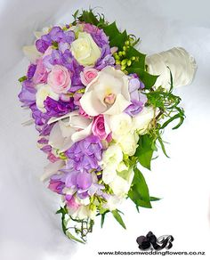 Pink roses, purple fressia, white orchids, white roses, and white ranunculus bouquet :).take out the pink and add some light blue Ranunculus Wedding Bouquet, Lilac Bouquet, White Ranunculus, Bouquet Wedding, Purple Orchids, White Orchids, White Roses, Pink Roses, Pink Purple