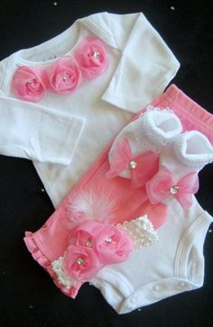 Adorable newborn girl layette with pink roses. Perfect for a newborn photo shoot