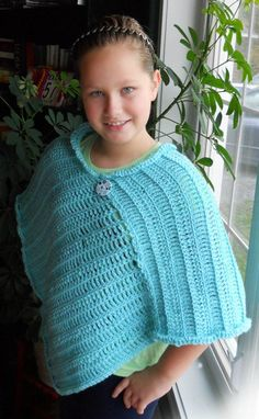 My daughter Olivia's poncho.  She chose a great color!  There are different sizes included in the pattern.  My daughter's poncho is size sm/med. Here's the link with the pattern:http://www.mikocoffey.com/blog/2011/01/06/free-crochet-pattern-icy-hombre-poncho/