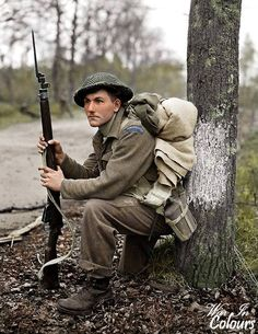 The liberation of The Netherlands. Private K. Earl, of the Perth Regiment, stops for a rest in the forest north of Arnhem, as the 5 Canadian Division advances. 15 Apr Arnhem (vic), The Netherlands. Canadian Soldiers, Canadian Army, Canadian History, British Soldier, British Army, Military Photos, Military History, George Vi, World History