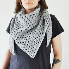 http://www.ravelry.com/patterns/library/sportive-unisex-triangle-shawl