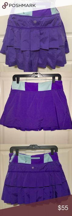 Lululemon purple and light blue pace setter skirt Lululemon purple and light blue pace setter skirt. 15 inches wide at waist when laying flat and 13 inches from top to bottom when laying flat. The back has tiered ruffles and a zipper pocket. Inside is lined. Very comfortable and stretchable material. Inside size tag was removed but I believe it was a size 6/8. Only worn once. In perfect condition. lululemon athletica Skirts Mini