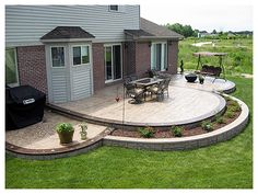 Larger flower bed. Small section for grilling and/or fire pit.