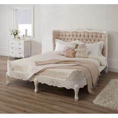 Bedroom. carved white stained wooden bed frame with cream tufted headboard and white pillocase also light brown blanket placed on walnut harwood floor. Alluring King Size Bed Frame Ideas For Redecorate Your Bedroom Furniture
