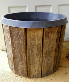 Cover big nursery pots with pallet wood boards for vintage style planters.