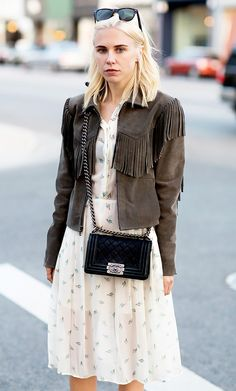 Courtney Trop of Always Judging wears a dress and a suede fringe jacket.