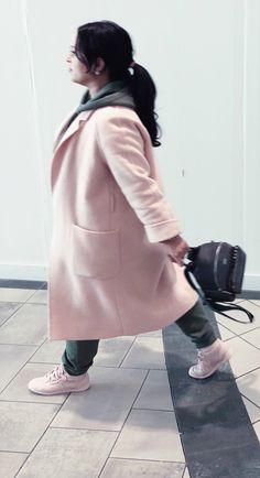 Lisa in the City style; pink coat; Club Monaco; green track suit; zara; backpack; pink runners; trainers; sneakers;Rebook; brunette; ponytail; casual wear; athleisure; fall style; winter style