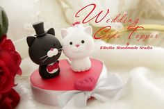 Cat cake topper - not because I'm crazy, but because I'll be a vet by then - Wedding Cake Topper-love cat by charles fukuyama, via Flickr