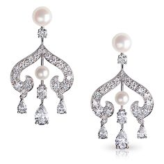 Fabergé ZHIVAGO EARRINGS. This piece is set in 18k white gold and features white round and pear shaped diamonds, and white pearls.