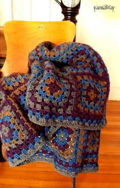 I love the colors of this afgan.  yarnaway: a crochet scrapbook: flannel-shirt granny