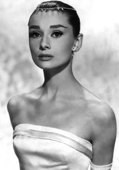 Audrey Hepburn in Givenchy, wearing a tiara that is actually a diamond necklace by Cartier, photo by Richard Avedon for the film Funny Face, 1956
