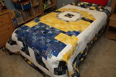 Pixelated minion quilt all ready for being loved by Don't Call Me Betsy, via Flickr