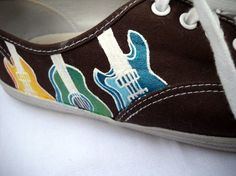 Shoes with guitar designs on the side.
