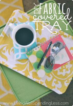 DIY Fabric Covered Tray. Love! So easy to make with an old cookie sheet, spray adhesive, & Mod Podge. Great gift idea!