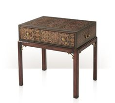 A carpet découpage lamp table, with a frieze drawer on square chamfered legs. The original George III.