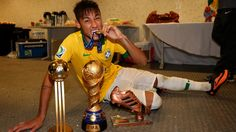 RIO DE JANEIRO, BRAZIL - JUNE 30: Neymar of Brazil poses with the trophy and his adidas Golden Ball and Bronze boot awards in the dressing room at the end of the FIFA Confederations Cup Brazil 2013 Final match between Brazil and Spain at Maracana on June 30, 2013 in Rio de Janeiro, Brazil. (Photo by Alex Livesey - FIFA/FIFA via Getty Images)