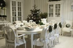 Martha Stewart Why do we love using white for the holidays? Perhaps its the way it sets off the table setting or the tree, or decorations...