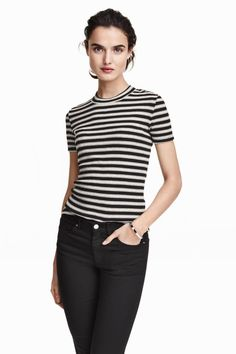 86fb91a52dab Ribbed top in soft fabric with short sleeves and wide ribbing at neckline.