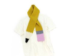 Pencil Scarf. This soft and cozy wooly scarf is knitted in 100% lambswool. Size: one size Material: 100% lambswool Care: hand wash only Designed and Handmade in the USA by Colette Bream