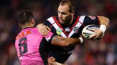 Simon Mannering of the Warriors is tackled.