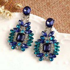 Statement Earrings Blue Green Rhinestones NEW Beautiful statement earrings with rhinestones in blue, geeen, and clear. Perfect to wear with a cocktail dress and trendy enough to wear with jeans. Love the versatility of this pair! Pierced posts. Brand new. boutique Jewelry Earrings