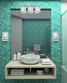 Rich teal is a beautiful color for bathroom decor.  Teal mosaic tiles add a lustrous aquatic element to this contemporary bathroom decor. This rich color is reminiscent of the deep ocean and vast skies, and brings a natural element from the outdoors in.