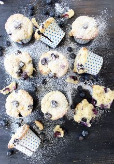 blueberry and ricotta muffins in polka dot muffin cups on a wooden table