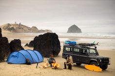 Camping at the beach. If you do this make sure you're above the high tide line. It doesn't look likes these guys are.