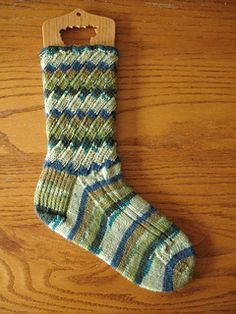 Swirl Socks are perfectly paired when using self striping sock yarn. The pattern is very easy, knit from cuff to toe with a little ribbing on the foot to keep it snug and well fitting. A simple bias pattern creates the swirl effect on the leg of the sock.
