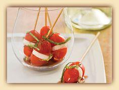 Love this idea for tapas: cherry tomato, mozzarella, basil ribbons, salt & pepper on a skewer