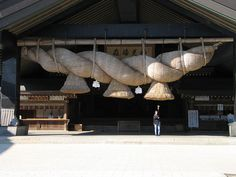 "Shimenawa (標縄・注連縄・七五三縄, literally ""enclosing rope"") are lengths of braided rice straw rope used for ritual purification in the Shinto religion. They can vary in diameter from a few centimetres to several metres, and are often seen festooned with shide. A space bound by shimenawa often indicates a sacred or pure space, such as that of a Shinto shrine.[1]"