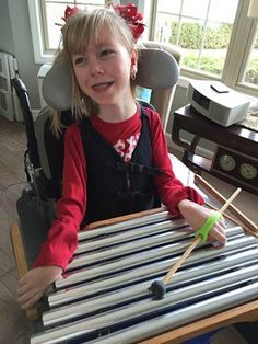 """Thank you soooo much for rush shipping on our new Eazyhold devices!! They are AWESOME!!! Now Chloe can play with her chimes, her musical triangle, eat suckers & color without dropping her markers! We will certainly be sharing your info with all her friends at school!"""