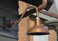 Copper lighting brings a grounded, elegant character to outdoor spaces. See more tips at our blog!