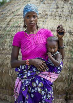 Benin, West Africa, Gossoue, a beautiful tattooed fulani peul woman with her baby