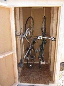 vertical bike storage shed. Maybe adult bikes vertically ad kids bikes horizontally, with shelf