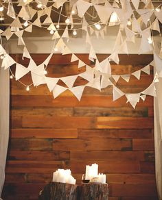 twinkle lights and triangle streamers and candles and tree trunks!  cute on cute on cute!  #weddingdecorations
